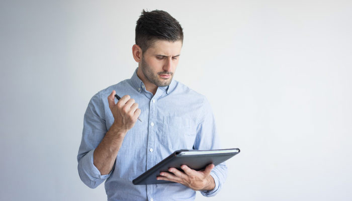 young businessman with folder and pen | Benefits of studying supply chain management